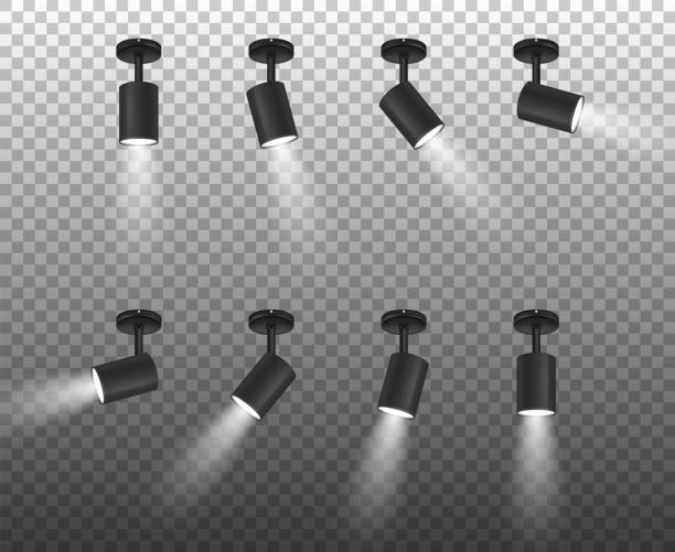 Vector Realistic 3d Black Spotlights Set in Different Slopes Closeup Isolated on Transparent Background. Design Template of Bright Lighting Glowing Spots with Ligh Effect for Ceremony, show, stage etc Vector Realistic 3d Black Spotlights Set in Different Slopes Closeup Isolated on Transparent Background. Design Template of Bright Lighting Glowing Spots with Ligh Effect for Ceremony, show, stage etc. stage light stock illustrations