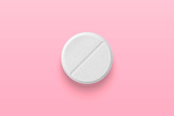 Vector Realistic 3d White Medical Pill Closeup Isolated on Pink Background. Design Template for Graphics, Banners. Female Health Concept. Women s Health Care, Vitamins and Supplements. Top View Vector Realistic 3d White Medical Pill Closeup Isolated on Pink Background. Design Template for Graphics, Banners. Female Health Concept. Women s Health Care, Vitamins and Supplements. Top View. aspirin stock illustrations