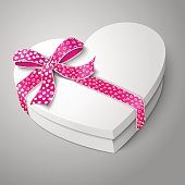 Vector realistic blank white heart shape box with pink and white ribbon and bow-knot isolated on gray background. For your valentines day or love presents design.