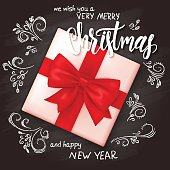 vector realistic christmas gift on top view with christmas lettering