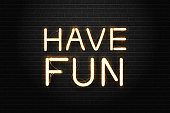 Vector realistic isolated neon sign of Have Fun lettering for decoration and covering on the wall background.