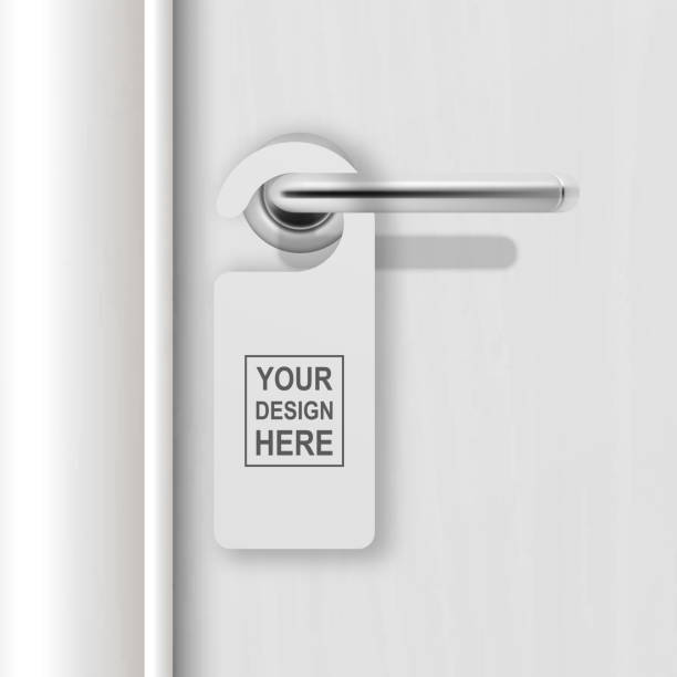 Vector realistic paper white blank door hanger on white realistic wooden door with metal silver handle background. Door hanger mockup. Design template for graphics. Full length door is in a clipping mask Vector realistic paper white blank door hanger on white realistic wooden door with metal silver handle background. Door hanger mockup. Design template for graphics. Full length door is in a clipping mask. knob stock illustrations