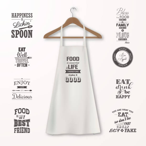 Vector realistic white cotton kitchen apron with clothes wooden hanger and quotes about food set closeup isolated on white. Design template, mock up for branding, graphics, advertising, printing Vector realistic white cotton kitchen apron with clothes wooden hanger and quotes about food set closeup isolated on white. Design template, mock up for branding, graphics, advertising, printing. apron stock illustrations