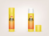 Vector realistic yellow tubes of glue stick