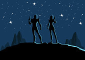 A silhouette style vector illustration of a couple of retro astronauts on a planet with outer space in the background. Wide space available for your copy.