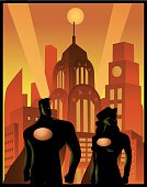 A retro style poster of a silhouette of superhero couple, a man and a woman, standing with an art deco themed city skyline in the background.