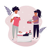 Vector scene with a boy and girl giving goods for charity. Cardboard box full of clothing, toys, shoes. Flat Design