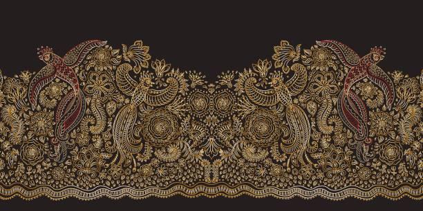 stockillustraties, clipart, cartoons en iconen met vector naadloze grens in etnische stijl. vliegende siervogels, gouden contour dunne lijntekening met folk ornamenten op een zwarte achtergrond. borduurwerk silhouet, behang, textiel afdrukken, inpakpapier - batik