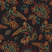 Vector seamless pattern in ethnic style.Exotic birds, colorful contour thin line fantasy flowers with folk ornaments on a black background. Embroidery silhouette, wallpaper, textile print, wrapping paper