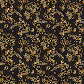 Vector seamless pattern in ethnic style.Exotic birds, golden contour thin line fantasy flowers with folk ornaments on a black background. Embroidery silhouette, wallpaper, textile print, wrapping paper