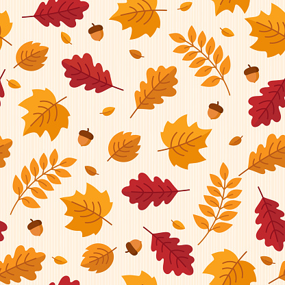 Vector seamless pattern of autumn leaves and acorns.