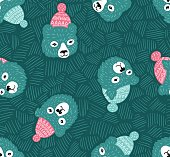 Vector seamless pattern with bears heads. Winter blue background.