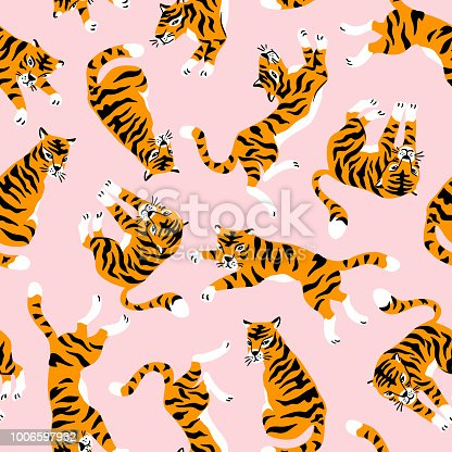 Vector seamless pattern with cute tigers on the pink background. Circus animal  show. Fashionable fabric design.