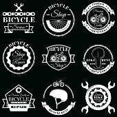 Bicycle service badge label logo set. Vector monochrome illustration in retro style. Bicycle rent, shop and repair typography.