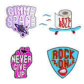 """Vector set of cartoon colorful stickers with phrases, words: """"Never give up"""" on pink female fist, """"Rock on"""" on guitar mediator, """"Let's Roll"""" on toilet paper, """"Gimme space"""" with planet."""