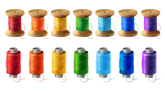 Vector set of colored thread spools for sewing