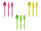 Vector 3d realistic set of disposable plastic tableware, knives, spoons, forks used for eating or serving food, isolated on background. Colorful cutlery for picnic, party, mockup of eco kitchenware