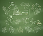 Vector set of cute chalk snowmen on green blackboard background.