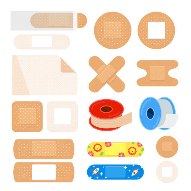 Vector set of different plasters. First aid equipment. Vector set of different plasters. First aid equipment. Medical patch for children. bandage stock illustrations
