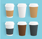 Vector set of disposable coffee cups. Realistic Paper coffee cups of different colors isolated.