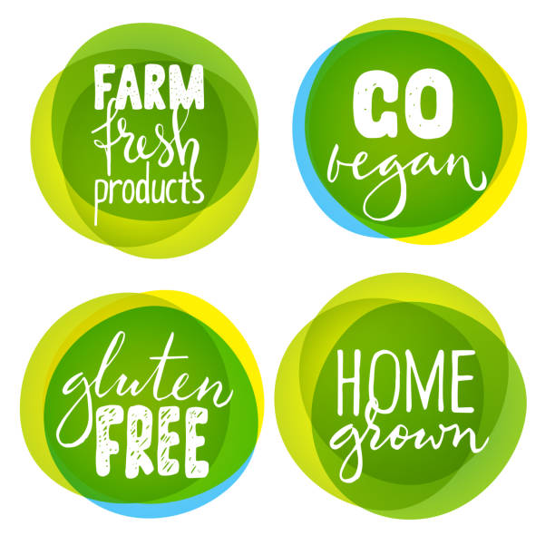 Vector set of four healthy food labels with lettering Set of four healthy food labels with lettering. Vegan food stickers. organic stock illustrations