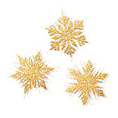 Vector set of glitter shiny snowflakes. Merry Christmas gold objects collection. Magic mist glowing. Stylish seasonal fashion banner. All elements are isolated and editable