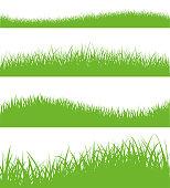 Vector set of green grass silhouettes - stock vector.