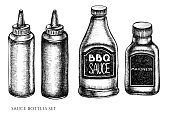 Vector set of hand drawn black and white sauce bottles