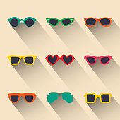 Vector set of icons of different shapes glasses in trendy flat style with long shadows effect