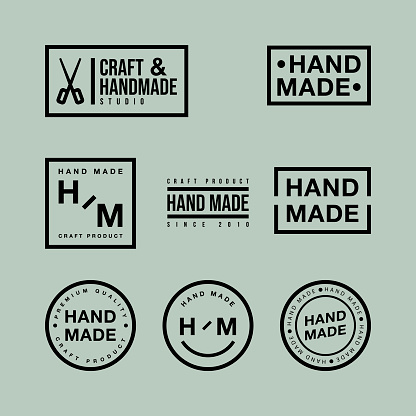 Vector set of linear badges and logo design elements for hand made in flat design on green backdrop