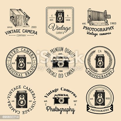 Vector set of old cameras icons. Vintage photo studio, salon signs, labels or badges