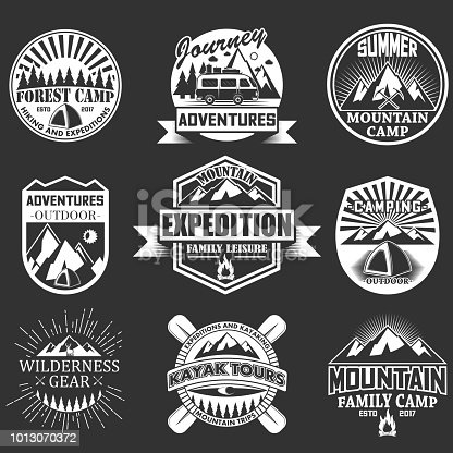Vector set of outdoor adventure emblems, badges, labels,  in retro style. Vintage chalkboard mountain forest camp hiking and expedition symbols, icons, typography design elements.