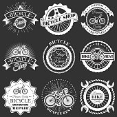 Vector set of bicycle shop repair rent service emblems, badges, labels, logo in retro style. Vintage chalkboard bike symbols, icons, typography design elements.