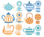 Vector set of teapots and cups with cute patterns. Tea-set cartoon style design. Flat vector illustration on white background.