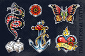 Set of most popular old school tattoo illustrations: snake, flower, butterfly, dice, anchor and heart with flame. All elements grouped and isolated on dark background. EPS10 vector illustrations.