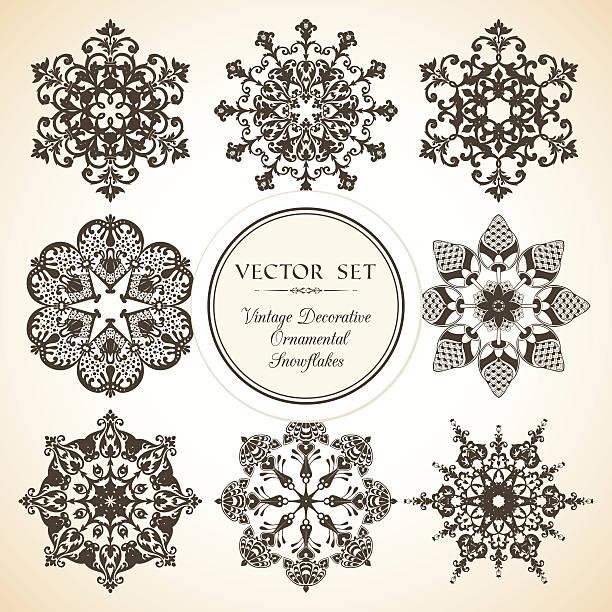 Vector set of vintage decorative ornamental snowflake Vector set of vintage decorative ornamental snowflake mistery stock illustrations