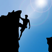 Vector silhouette of a man who climbs rocks.