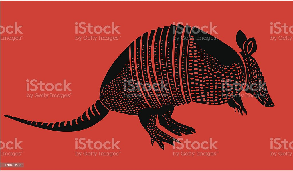 Vector silhouette of an armadillo isolated in red vector art illustration