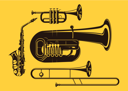 Vector silhouette of brass instruments in yellow background