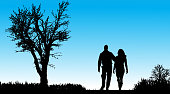 Vector silhouette of couple in nature along the beautiful days.