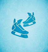 Winter vector background: skates on blue ice.