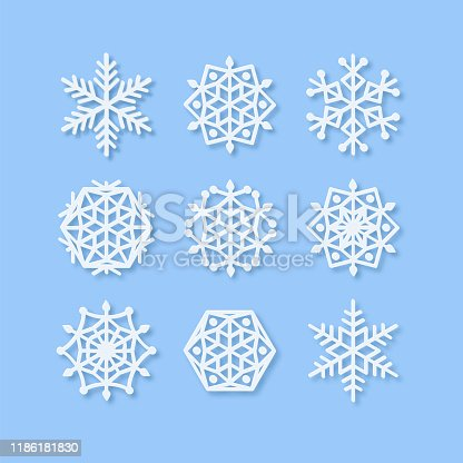 Christmas card with paper snow flake. Vector Set of Realistic Snowlakes shape. Papercut snow flake silhouette isolated on blue. Winter weather theme decoration object. Digitally generated Symmetric icons.