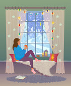 Girl sits by the Christmas decorated window with a cup of hot drink, looks out the window at the winter evening landscape. Vector illustration with texture.