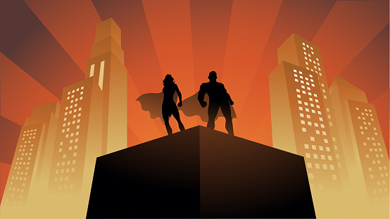 Vector Superhero Couple Silhouette on a Rooftop with Buildings in the Background