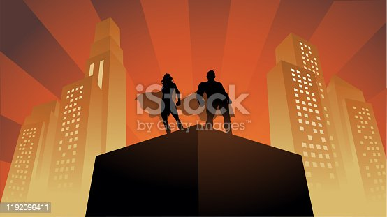 A silhouette style vector illustration of a couple of superheroes standing on a rooftop with tall buildings in the background. Wide space available for your copy.