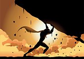 A silhouette style illustration of a superhero lifting a falling heavy rock creating debris and dust around. Copy space available for your text in the rock area.