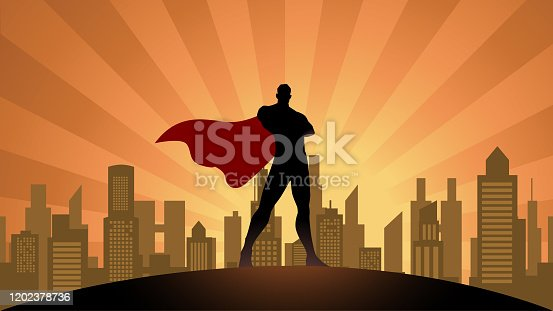 A silhouette style vector illustration of a superhero standing with city skyline in the background. Wide space available for your copy.
