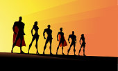 A silhouette style vector illustration of a team of superheroes standing with light coming from the behind. Wide space available for your copy.