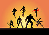A silhouette style illustration of a team of superheroes ready for action.
