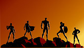 Vector Superhero Team Silhouette on Rocks